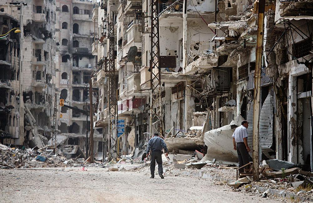 Gatuvy från Adel Khankans hemstad Homs. Kriget i Syrien är inne på femte året. Över tolv miljoner människor är på flykt från sina hem, de flesta inne i Syrien eller dess grannländer. Foto: TT NYHETSBYRÅN